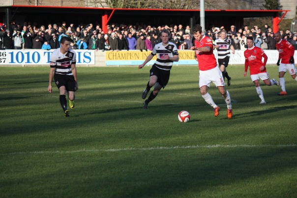 Gaz Seddon shapes to shoot in the first half